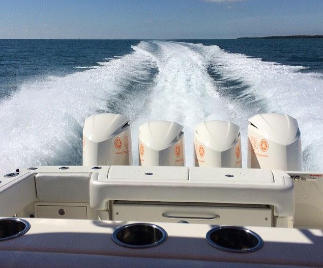 Quad Yamaha 350's behind DJ Laz's boat