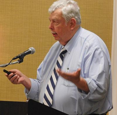 Chairman Dan Maxim presenting closing thoughts at NBSAC97