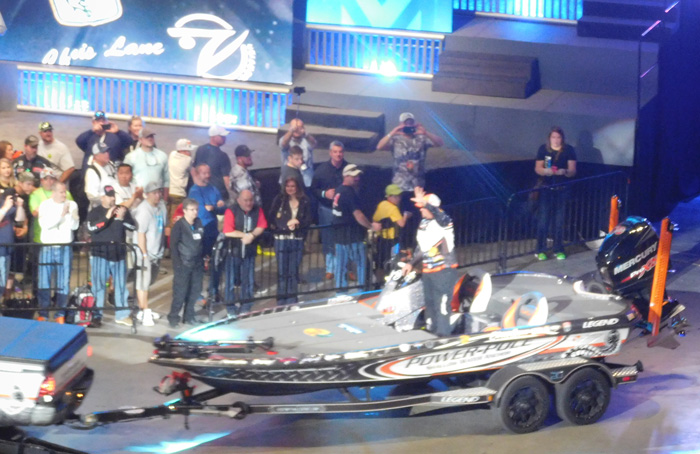 Chris Lane waving while being trailered in during Bassmaster Classic 2016 Day 2 weigh-in