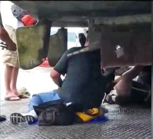 Investigators examine the houseboat