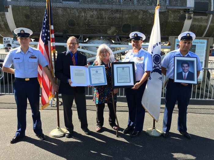 Marion Irving deCruz receiving USCG Public Service Commendation
