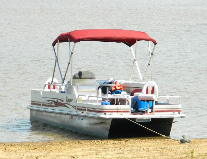Pontoon Boat anchor on shore