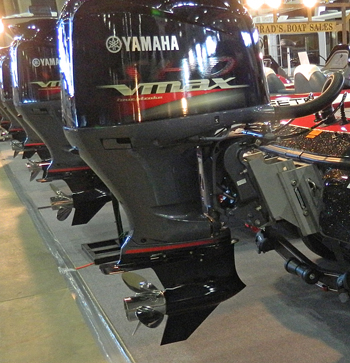 Large outboard motors lined up at 2014 Tulsa Boat Show.
