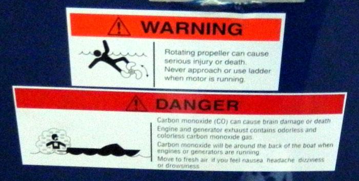 Propeller warning near carbon monoxide warning at 2013 Tulsa Boat Show