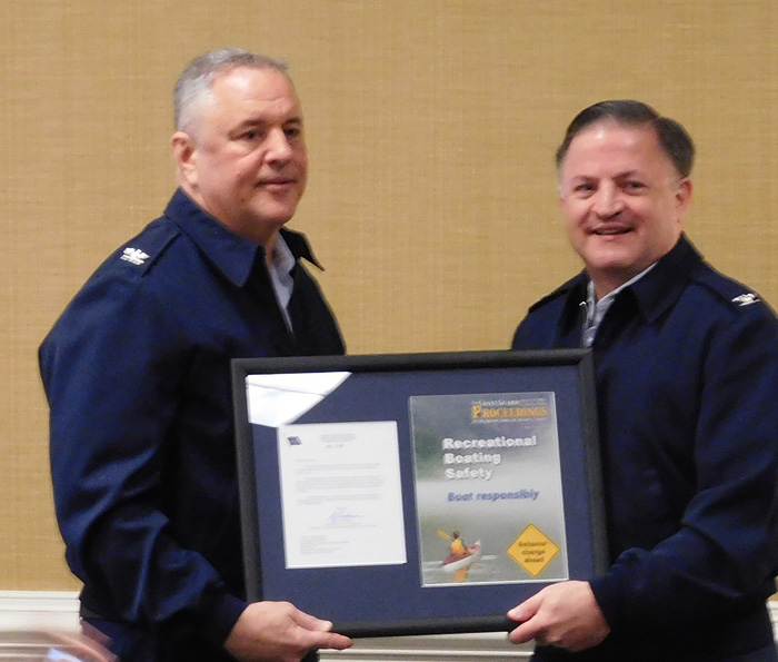Captain Gifford (right). Award shows the Proceedings magazine.