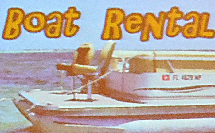 Rental pontoon boat with seats forward of the fence