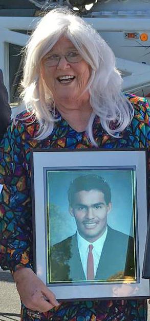 Marion Irving de Cruz with photo of her son Emilio