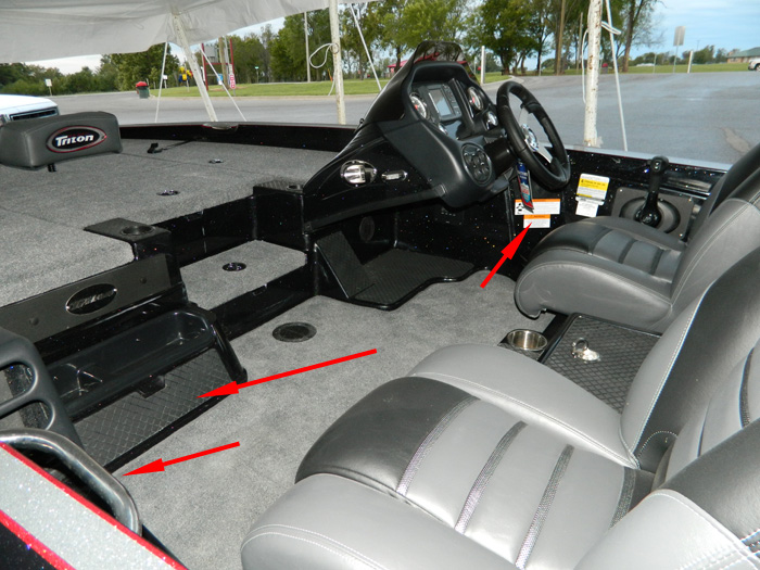 Triton bass boat with passenger grab rail, passenger foot brace, and a high speed turns warning.